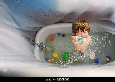 Boy (2-3) playing with toys in bath - Stock Image
