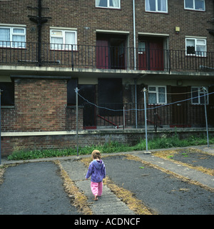 A young girl playing in a council estate in Bristol, UK. - Stock Image
