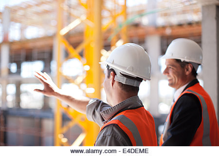 Construction workers working on construction site - Stock Image