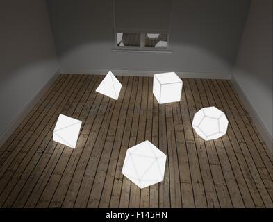 Modèles illuminés des cinq tissus platoniques sur le sol dans la salle en studio - Image