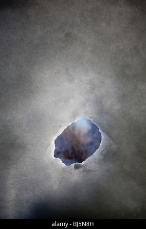 Small peep hole on snow wall - Stock Image