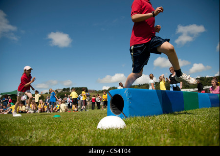 Children at the annual School sports day at a small primary school, UK - Stock Image