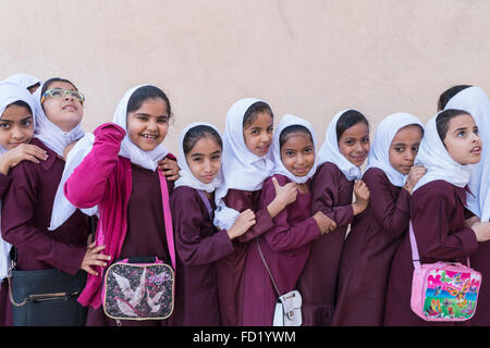 Omani schoolgirls visiting Nizwa Fort in Oman - Stock Image