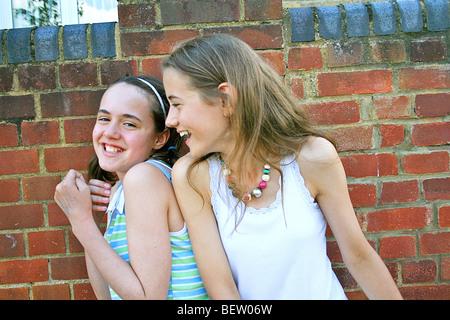 two girls larking around and having fun - Stock Image