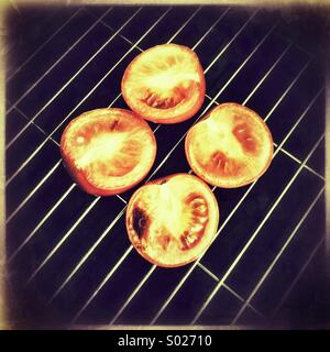 Tomatoes on grill pan - Stock Image