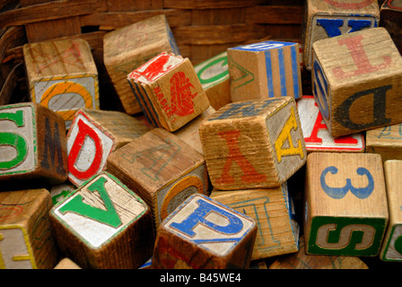 Vintage wooden blocks with colorful letters and numbers on them, in an antique store. - Stock Image