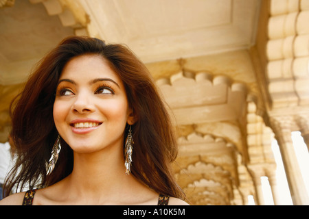Close-up of a young woman smiling, Agra Fort, Agra, Uttar Pradesh, India - Stock Image