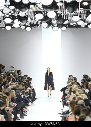 Paris, France. 28th Feb, 2014. A model wears a creation by Belgian designer Raf Simons as part of the Christian Dior fall/winter 2014 /2015 collection presented during the Paris Pret a porter fashion week, in Paris, France, 28 February 2014. Paris Pret a porter fashion shows run until 5 March 2014. Photo: Hendrik Ballhausen - NO WIRE SERVICE/dpa/Alamy Live News - Stock Image