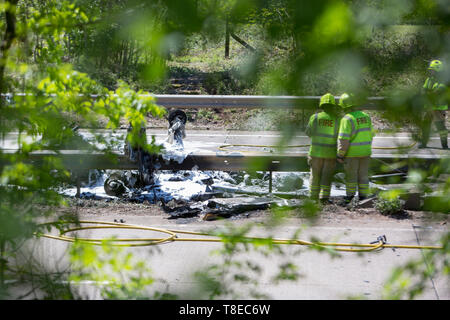 Abergaveny, Wales, UK. 12th May, 2019. 12.05.19 The plane crash scene on the A40 between Raglan and Abergavenny, South Wales. A light aircraft crashed into the busy dual carriageway after allegedly clipping a power line. Credit: James Davies/Alamy Live News - Stock Image