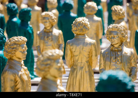 Bonn, Germany. 15th May, 2019. Smiling Beethoven statues stand on Münsterplatz. From 17 May to 2 June 2019, the art installation 'Ludwig van Beethoven - Ode to Joy', which consists of 700 Beethoven statues about one meter tall, will be on display in front of the Beethoven Monument on Münsterplatz. Credit: Rolf Vennenbernd/dpa/Alamy Live News - Stock Image
