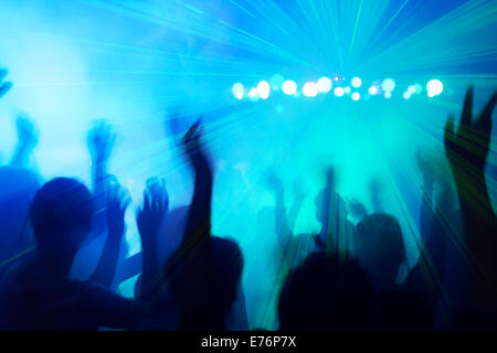 People silhouettes dancing to the disco beat. - Stock Image