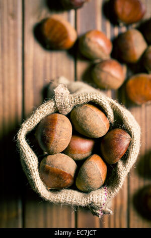top view of chestnuts in jute bag - Stock Image