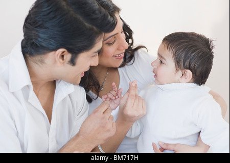 Parents playing with their son - Stock Image