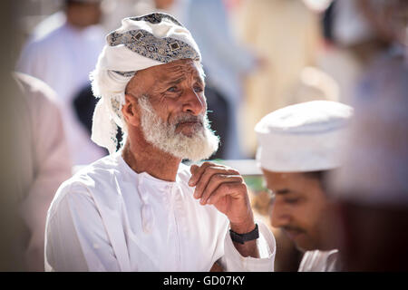 NIZWA, OMAN - APRIL 24 2015:Omani old man at the traditional market or souq in Nizwa, Oman. - Stock Image