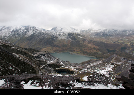 Disused buildings and waste slate over looking Llyn Peris in at Dinorwig quarry in Llanberis North Wales - Stock Image