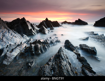 Dramatic coastal scenery at sunset, Hartland Quay, North Devon, England. Spring (April) 2010 - Stock Image