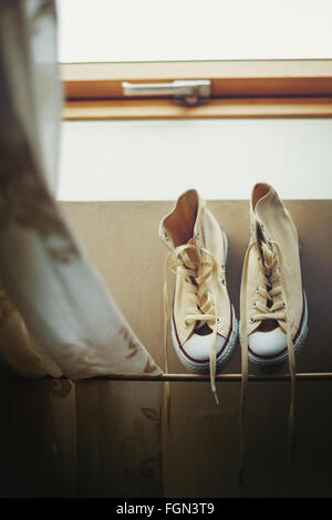 Beige Sneakers Getting Dried Near Window. Image Toned. Selective Focus. - Stock Image