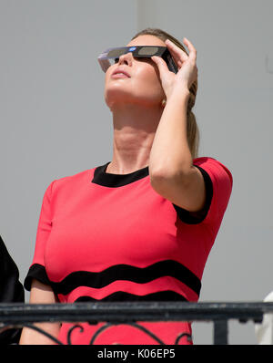 Ivanka Trump looks at the partial eclipse of the sun from the Blue Room Balcony of the White House in Washington, DC on Monday, August 21, 2017. Credit: Ron Sachs / CNP   - NO WIRE SERVICE - Photo: Ron Sachs/Consolidated News Photos/Ron Sachs - CNP - Stock Image