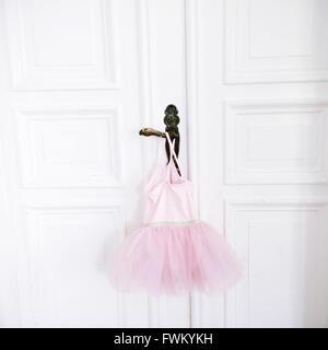 Pink Tutu Hanging On Door Handle - Stock Image