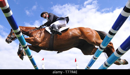 Badminton Estate, Badminton, UK. 5th May, 2019. Mitsubishi Motors Badminton Horse Trials, day 5; Kristina Cook (GBR) riding BILLY THE RED clears fence 5 during the show jumping test on day 5 of the 2019 Badminton Horse Trials Credit: Action Plus Sports/Alamy Live News - Stock Image