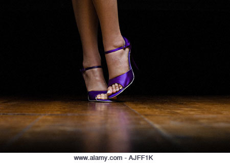 Woman wearing purple high heeled shoes - Stock Image