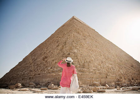 Mature woman tourist at The Great Pyramid of Giza, Egypt - Stock Image
