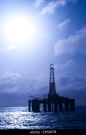On offshore floating oil drilling rig.  Back light view.  Coast of Brazil, 2010. - Stock Image