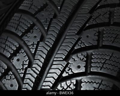 Closeup of a winter car tire tread texture - Stock Image