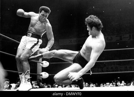 Apr. 11, 1956 - Tokyo, Japan - MUHAMMAD ALI or CASSIUS CLAY, as the dominant heavyweight boxer of the 1960s and 1970s, Muhammad Ali won an Olympic gold medal, captured the professional world heavyweight championship on three separate occasions, and successfully defended his title 19 times. The picture shows Ali during a fight in Tokyo, Japan. (Credit Image: © KEYSTONE Pictures USA/ - Stock Image