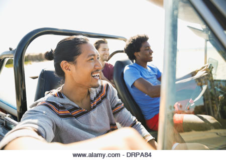 Male friends enjoying road trip - Stock Image