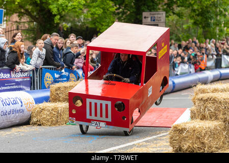 Traditional British bank holiday Monday event soapbox derby, involving handmade carts racing down a course using gravity alone for power. Event organised by the Rotary Club of Billericay for charity down a closed section of road with added jumps and chicane - Stock Image