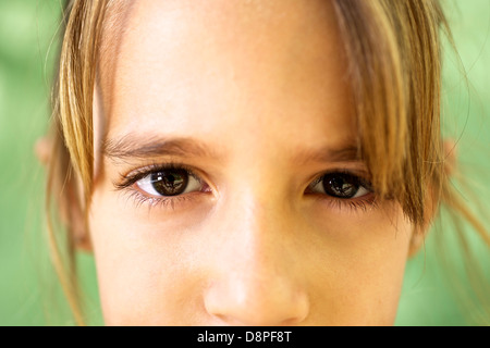 Young people and emotions, portrait of serious girl looking at camera. Closeup of eyes - Stock Image