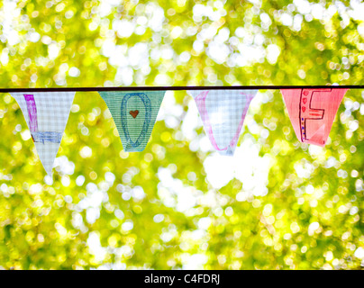 A line of bunting flags spelling 'Love' - Stock Image