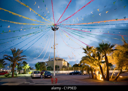 Decorated street during dusk - Stock Image