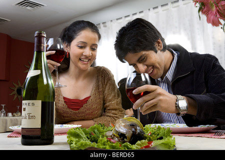 Couple enjoying a meal - Stock Image