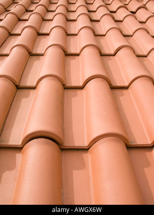New orange roof tiles close up in Portugal - Stock Image