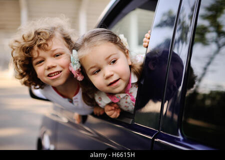 children look out from a car window - Stock Image