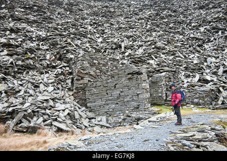 Snowdonia National Park, Gwynedd, Wales, UK. 17th February, 2015. A hiker visits the abandoned Rhosydd Slate Quarry - Stock Image