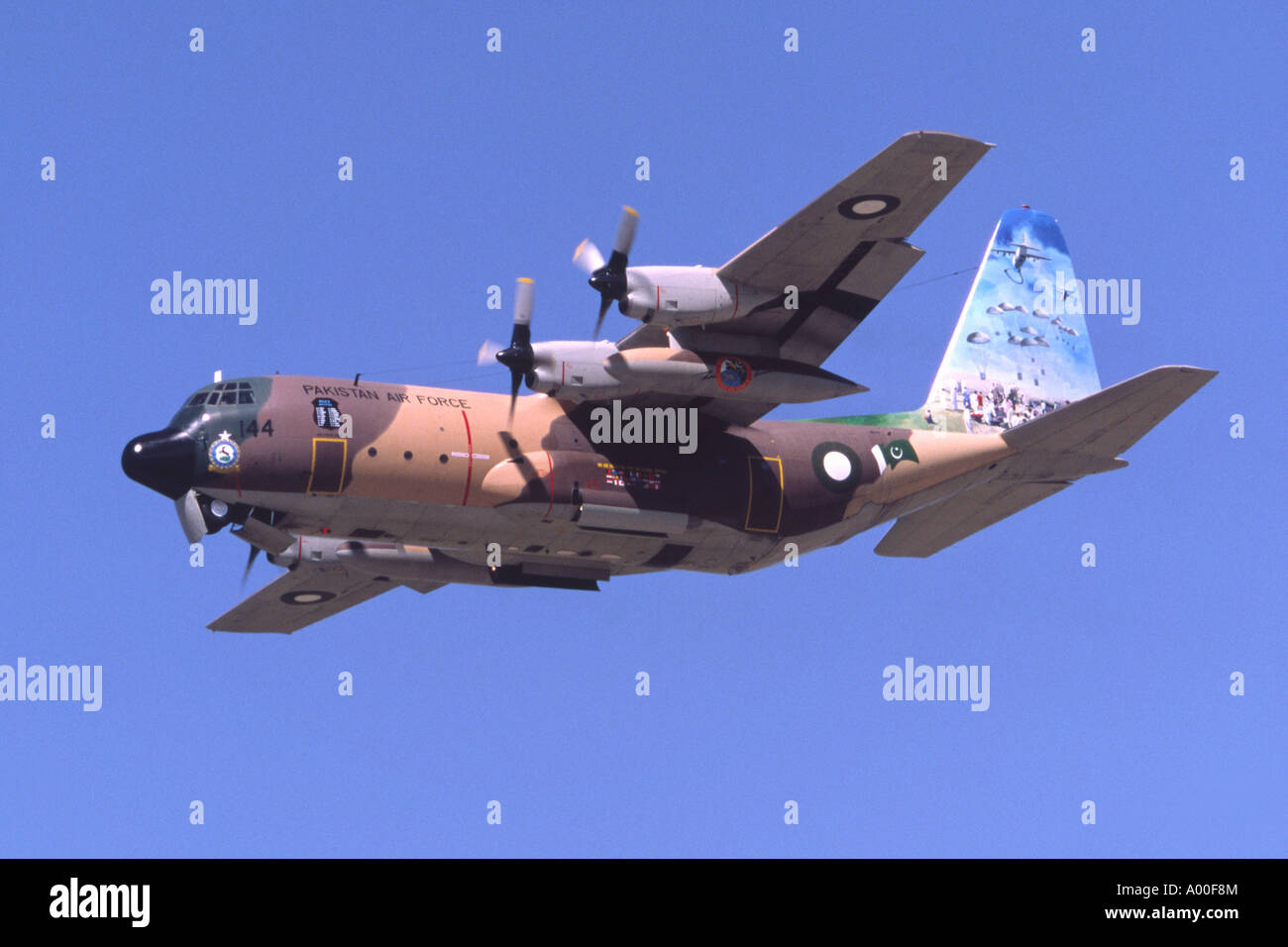 Lockheed C-130B Hercules operated by the Pakistani Air Force climbing out after take off from RAF Fairford - Stock Image