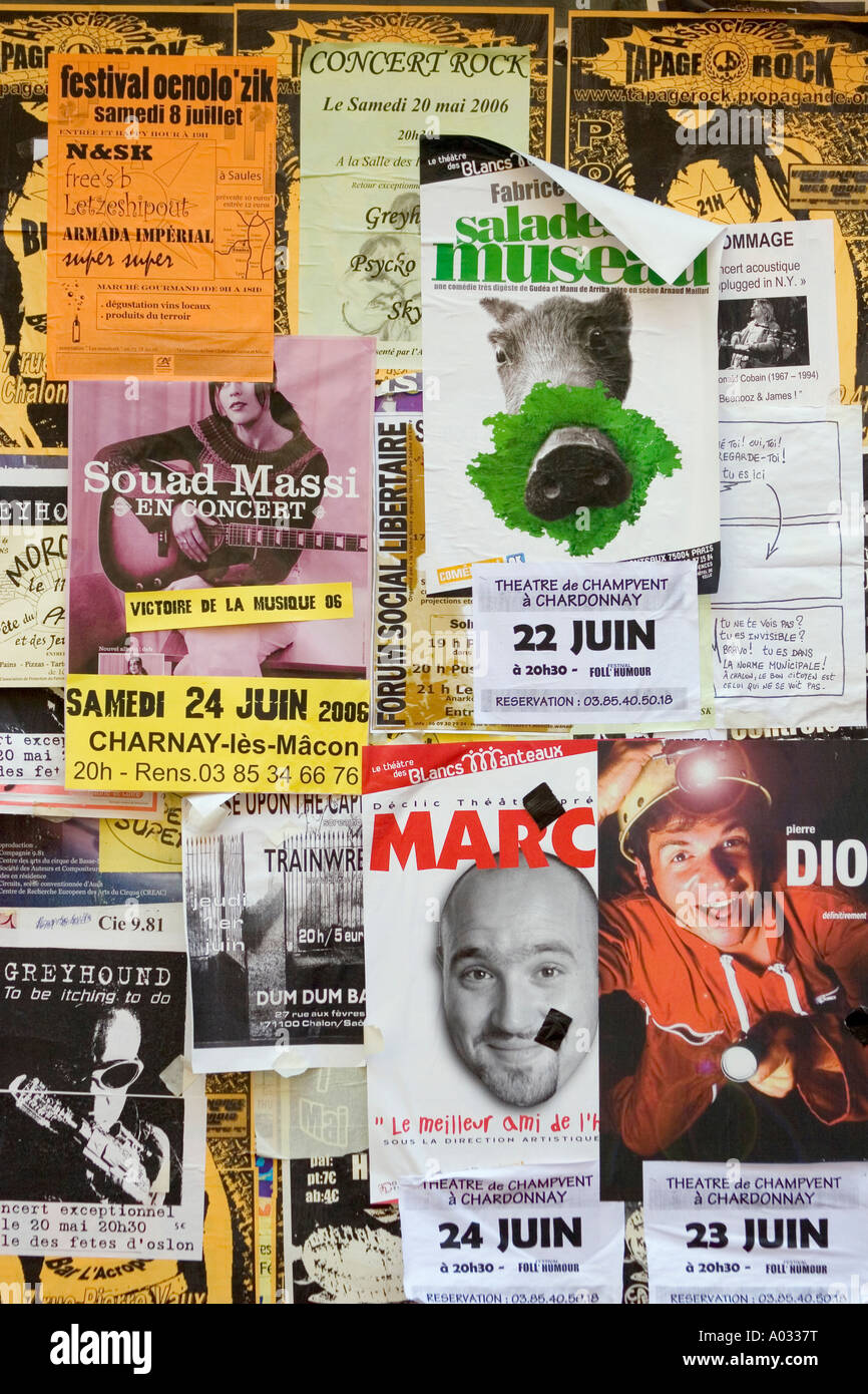 Posters on wall in Chalon Sur Saone, France. - Stock Image