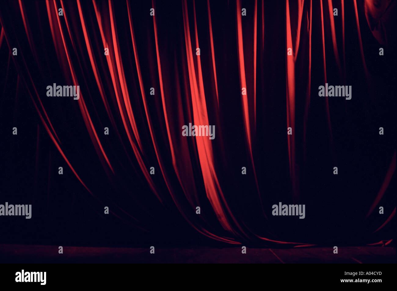 Red theatre curtain on a stage - Stock Image