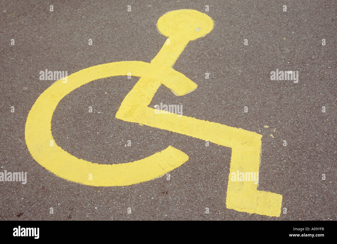 Symbol Of Person In Wheelchair Painted In Yellow On Road Or Carpark