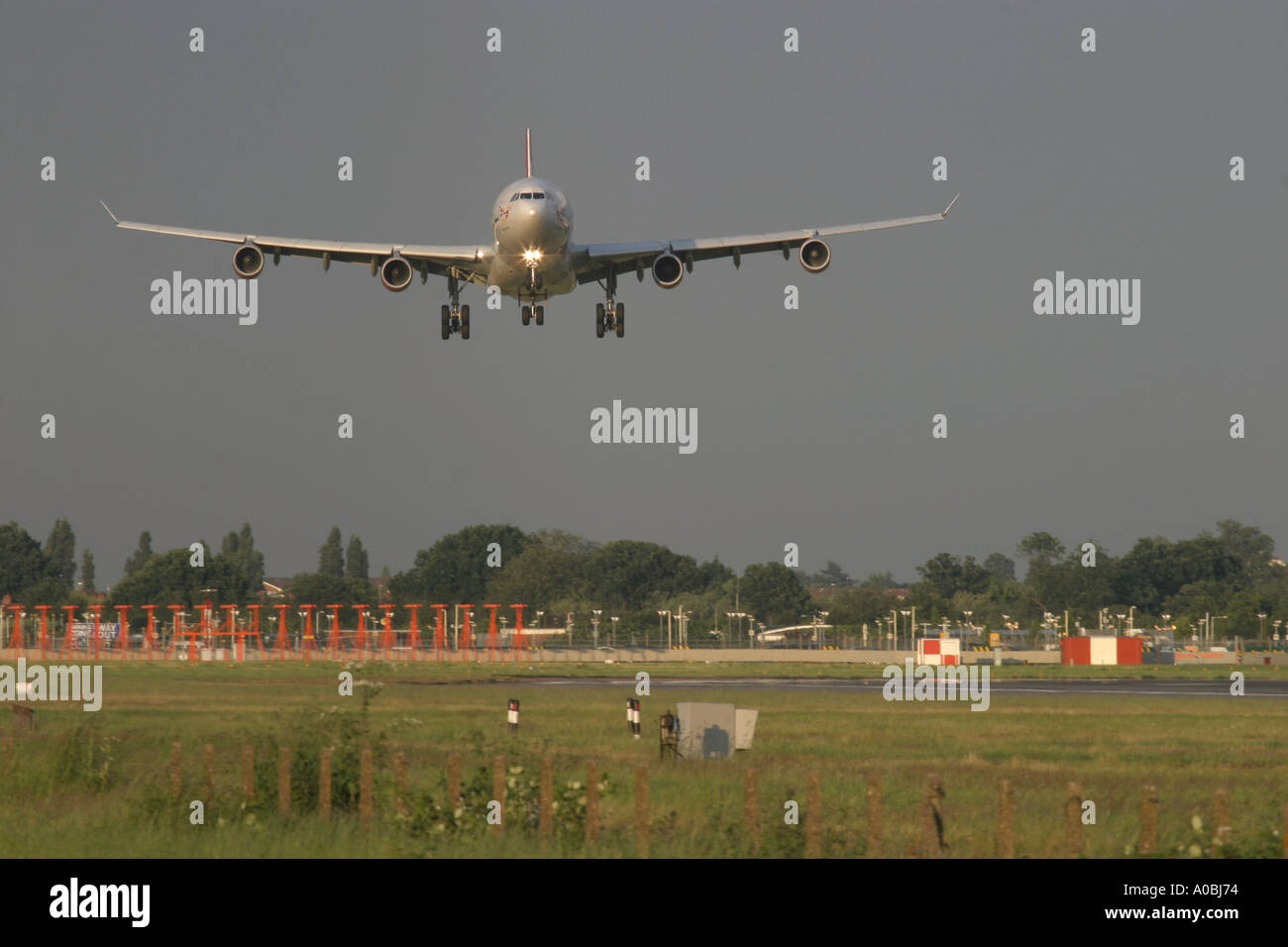 Airbus A340 coming to land in strong crosswind London Heathrow Airport England UK - Stock Image
