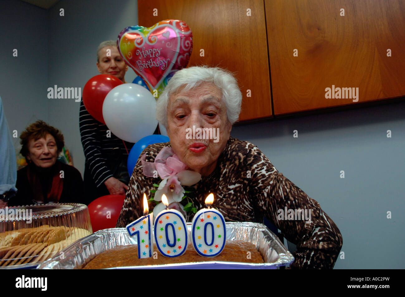 100 Year Old Woman Blows Out Candles On Her Birthday Cake