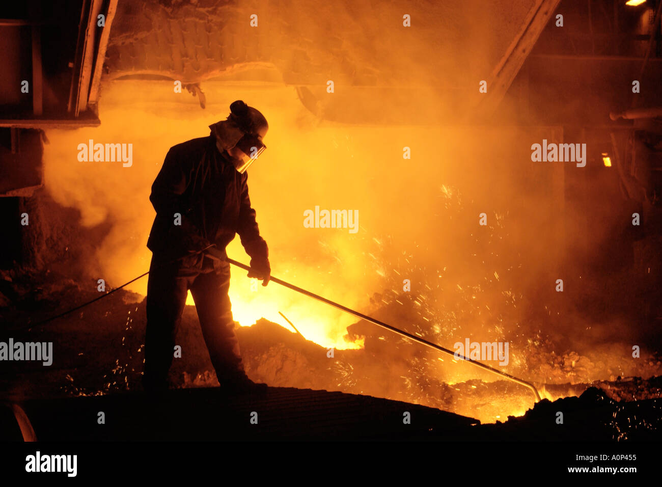 Team member taking iron samples using a lance on Blast Furnace No 5 at Corus Steelworks Port Talbot South Wales Stock Photo