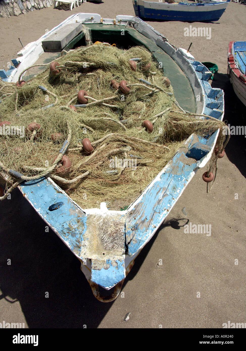 Wooden Fishing Boat, Fuengirola Port, Costa del Sol, Spain nets beach sand wood wooden  boat boats tackle net nets - Stock Image