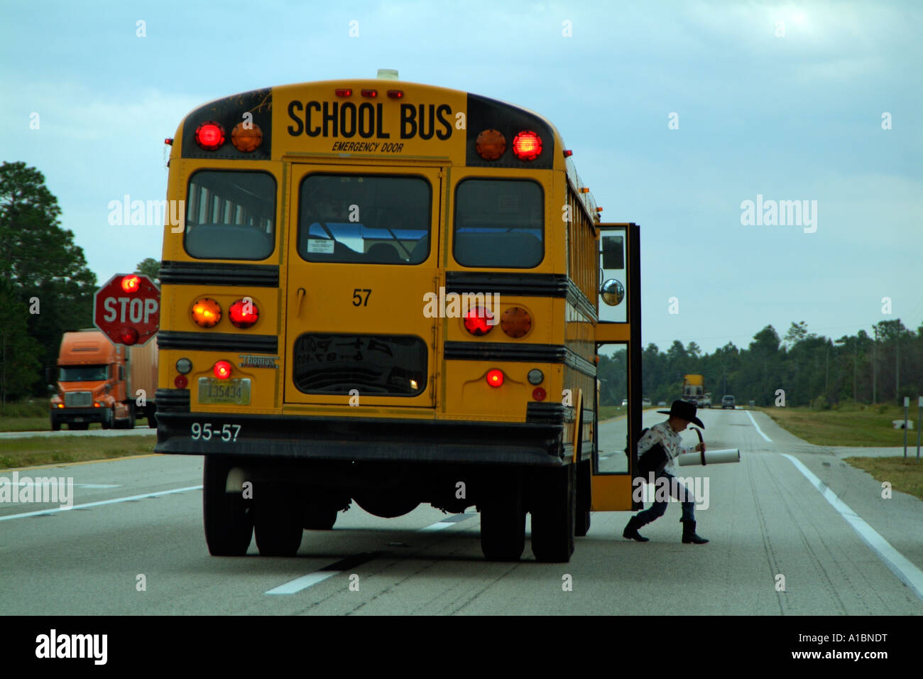 school bus dropping off a child on the highway usa the thomas built