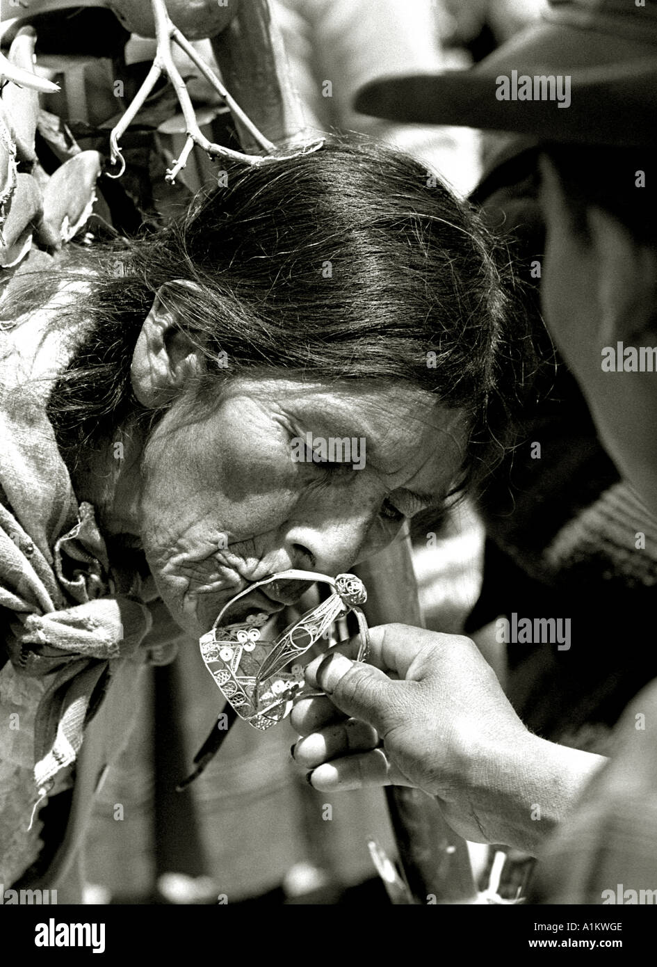 Indian woman kissing the crown of miracles at the festival of the virgin of Cocharcas in Sapallanga Huancayo peru - Stock Image