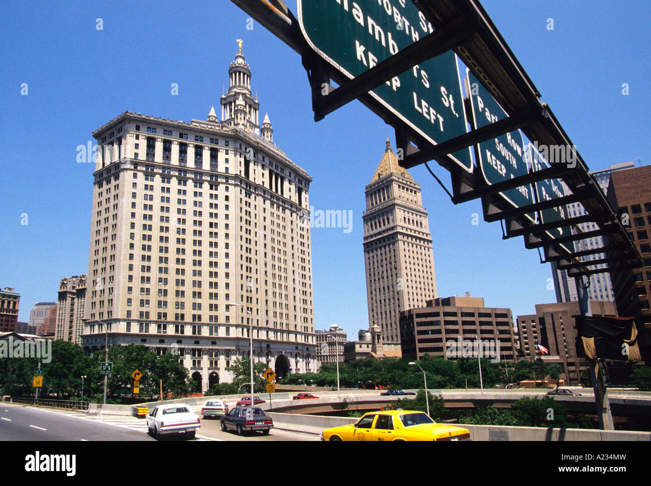 New York City Lower Manhattan The Municipal Building Exit Signs From Brooklyn Bridge USA - Stock Image