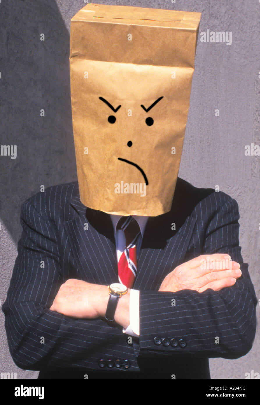 Businessman With Brown Paper Bag Over His Head Frowning - Stock Image